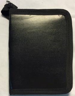 Small black leather binder
