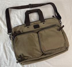 Brown shoulder bag with leather details.