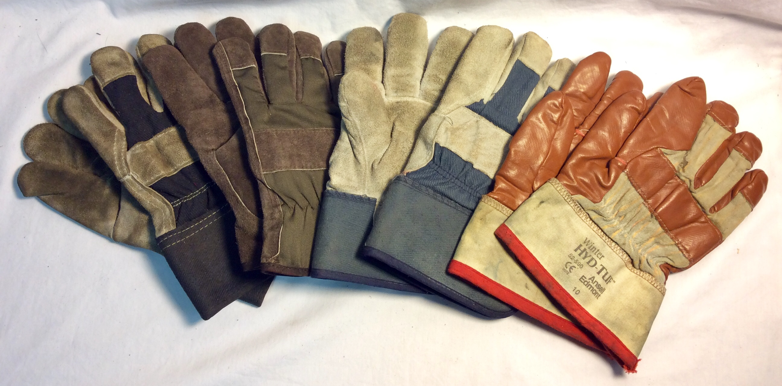 Assorted pairs of leather palm work gloves, assorted colours