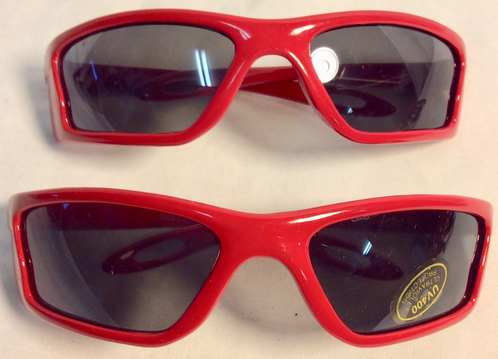 Kids sunglasses with red plastic frame