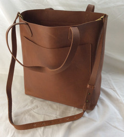 Light-brown faux leather purse/shoulder bag. Pockets inside and out.