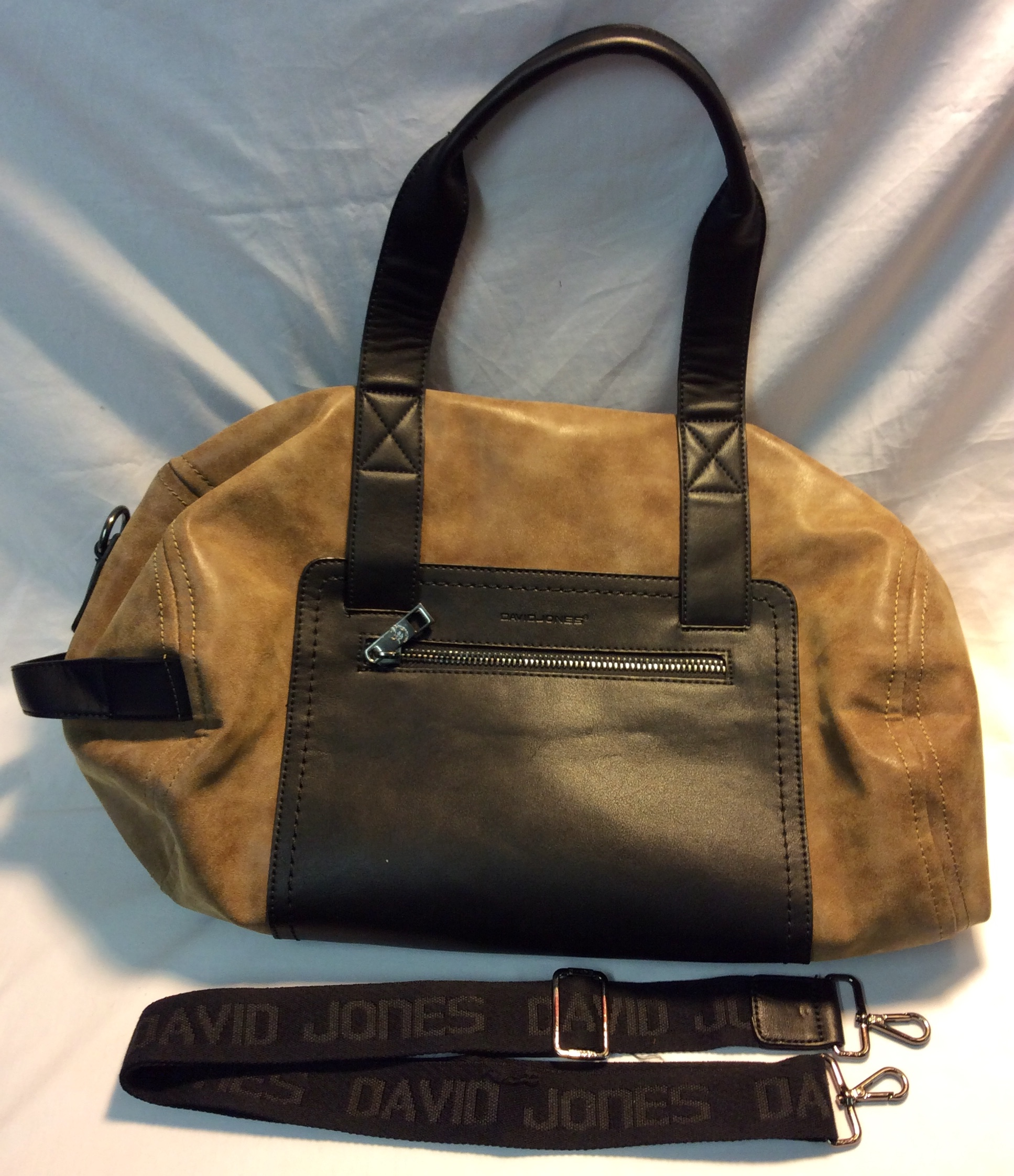 Light brown and black leather bag