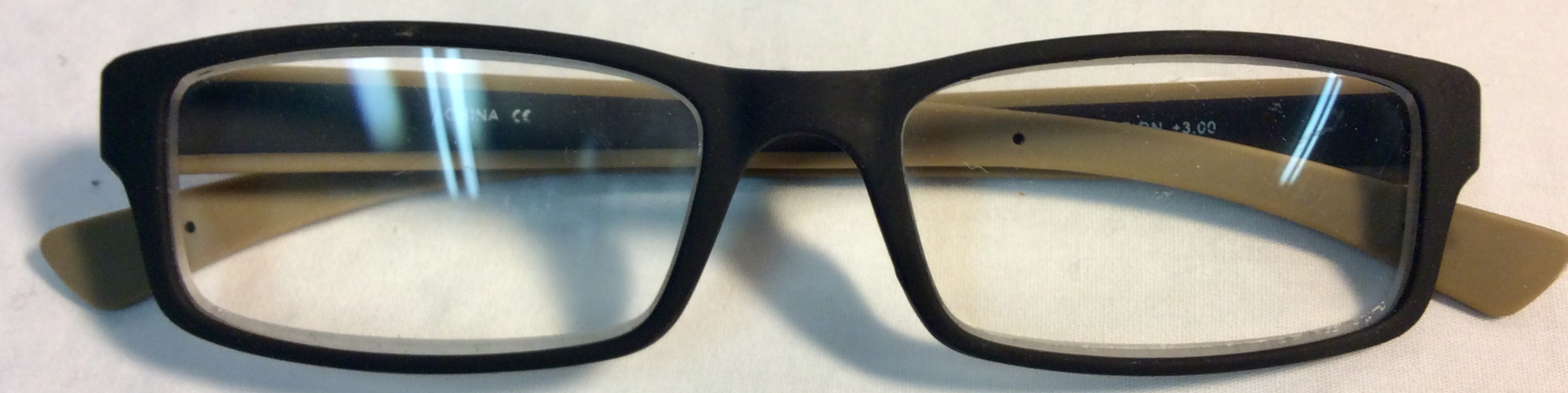 Rubbery black and brown square frame