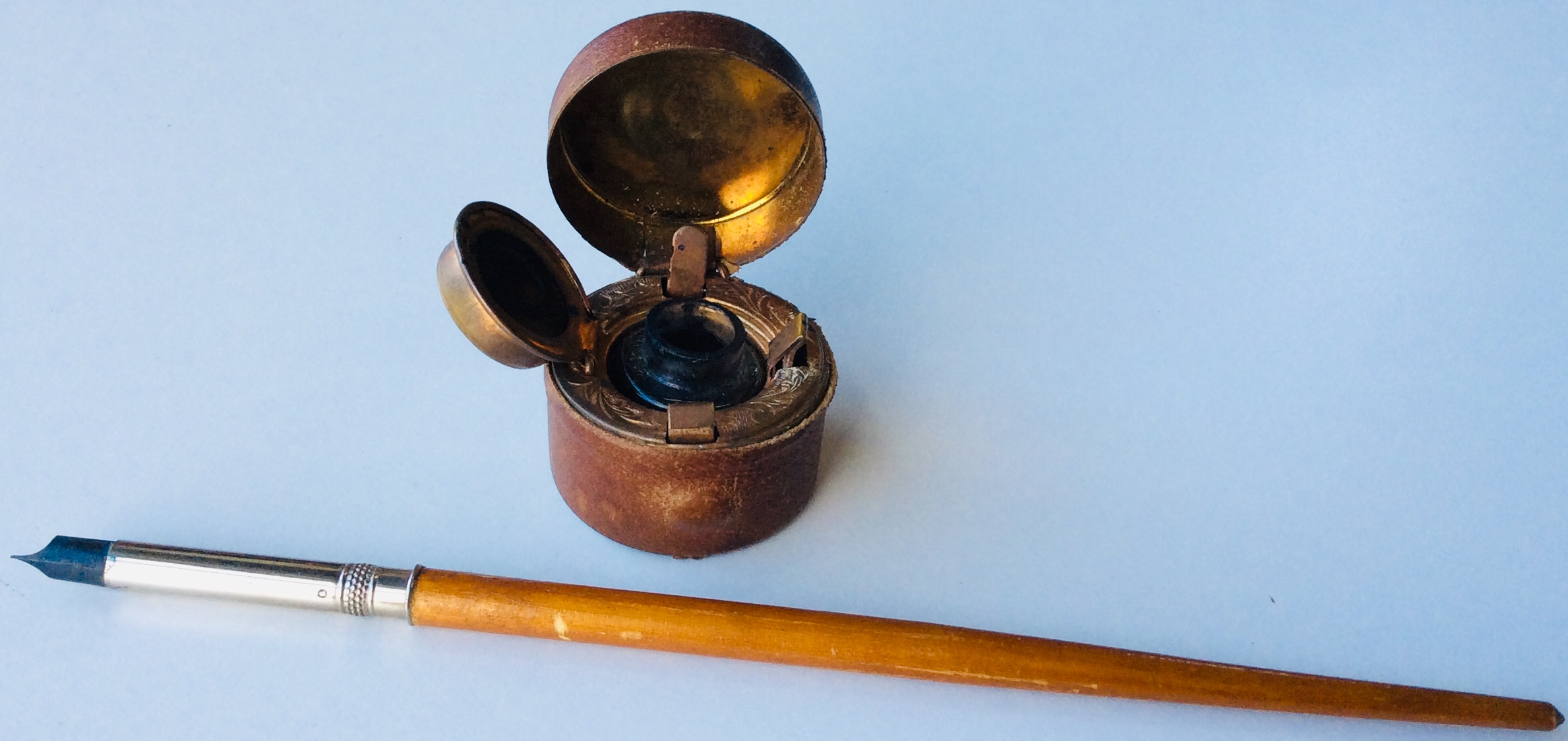 Antique inkwell with pen