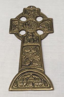 Detailed gold cross emblem