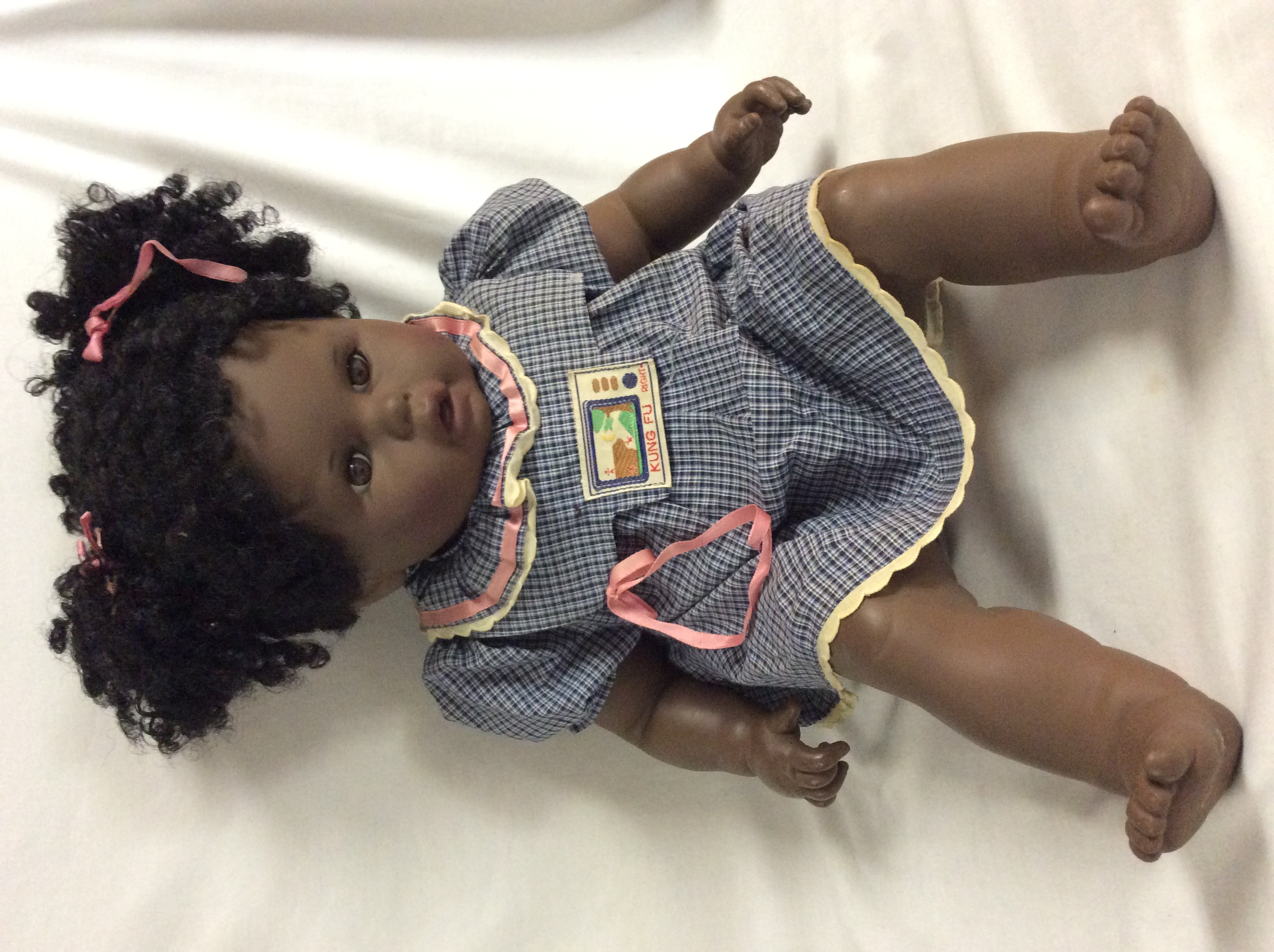 Large black baby girl doll