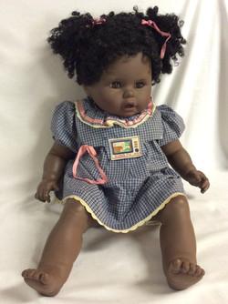 Large black baby girl doll