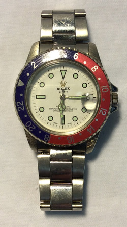 Rolex White & green face, blue & red
