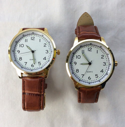 Precision Quartz watches with leather band.
