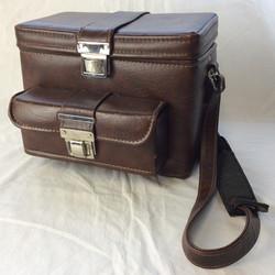 Vintage fully loaded analogue camera bag with shoulder strap