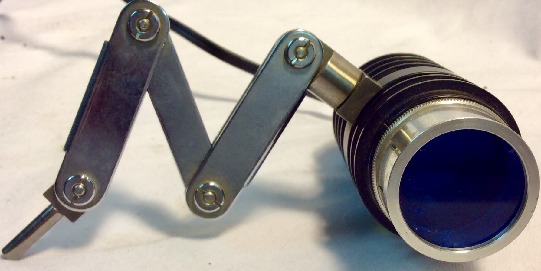 Antique optical microscope blue light