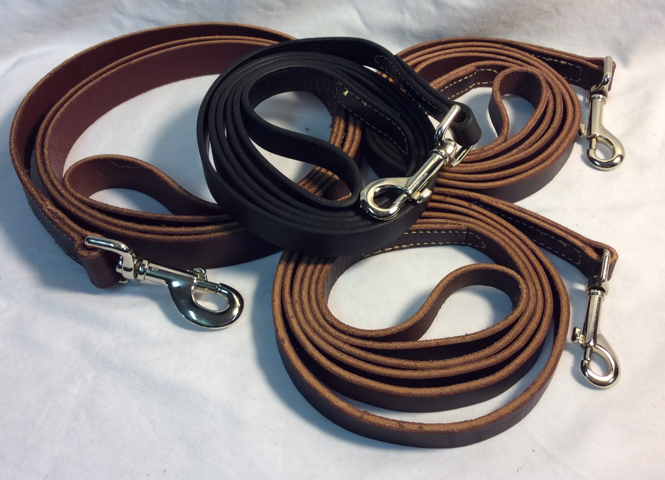 Leather leashes with different strap width. 3 brown and 1 black