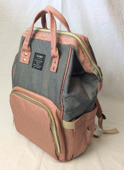 Vinyl grey and pink Qimiao Baby diaper backpack.
