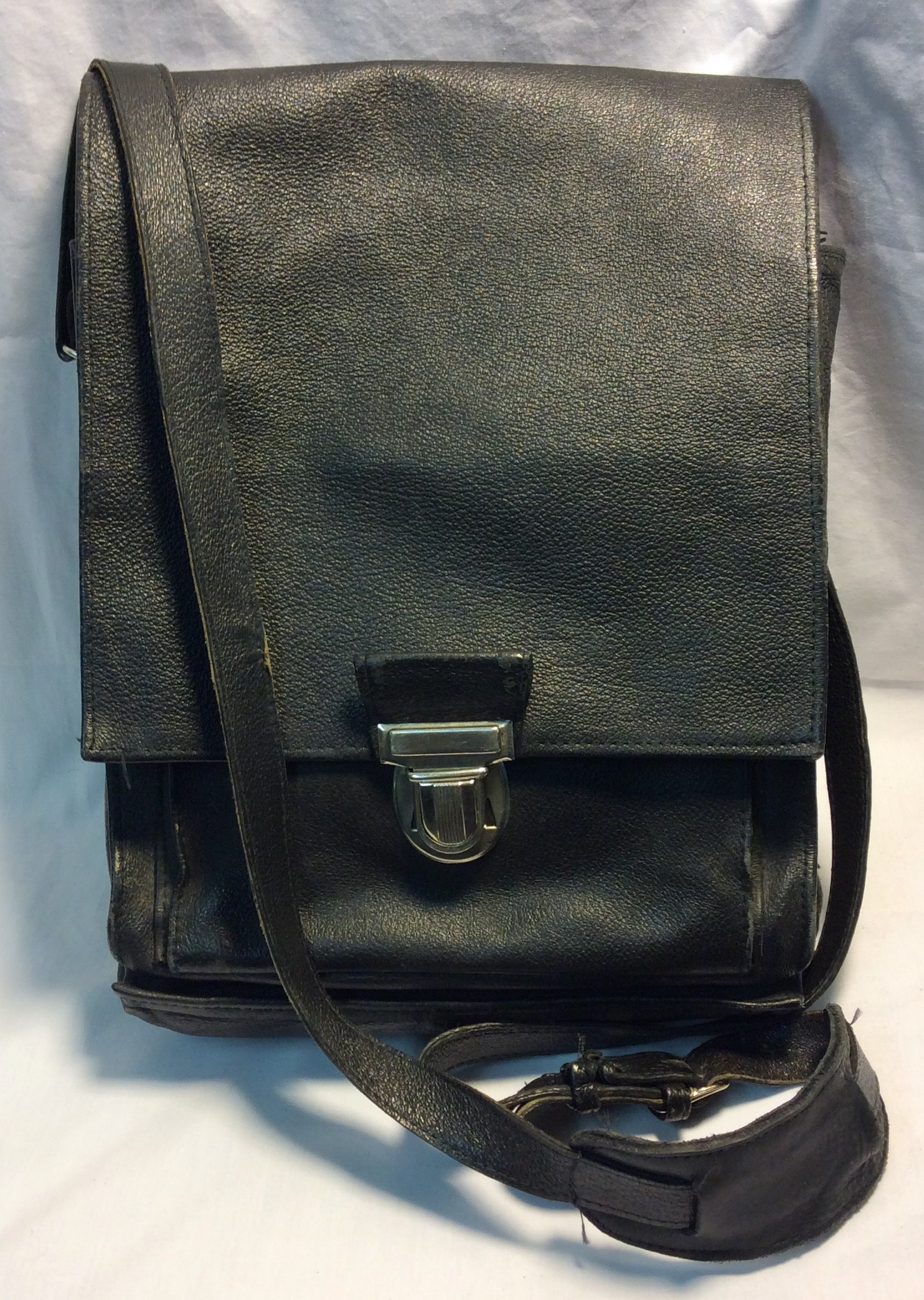 Black leather bag with silver clasp