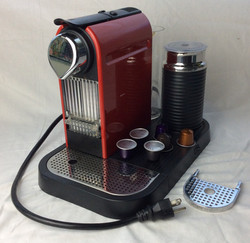 Red nespresso at-home espresso machine. Includes 13 coffee pods. (working)