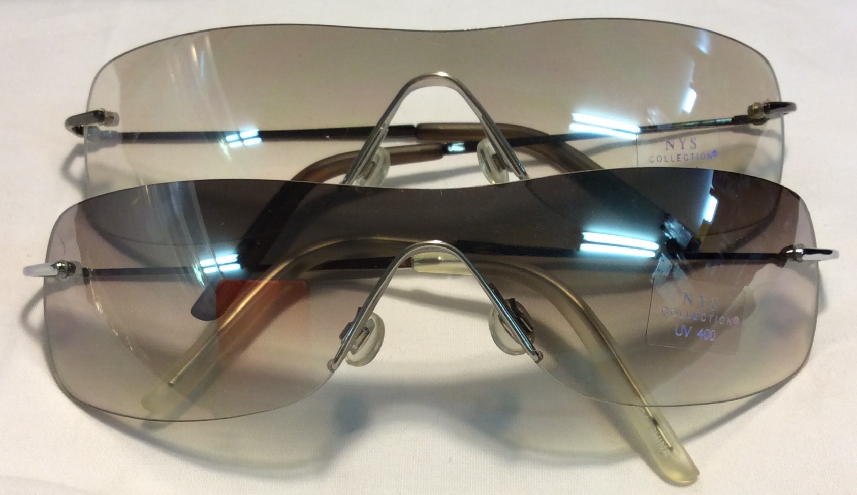 Thin silver metal frames, clear/grey