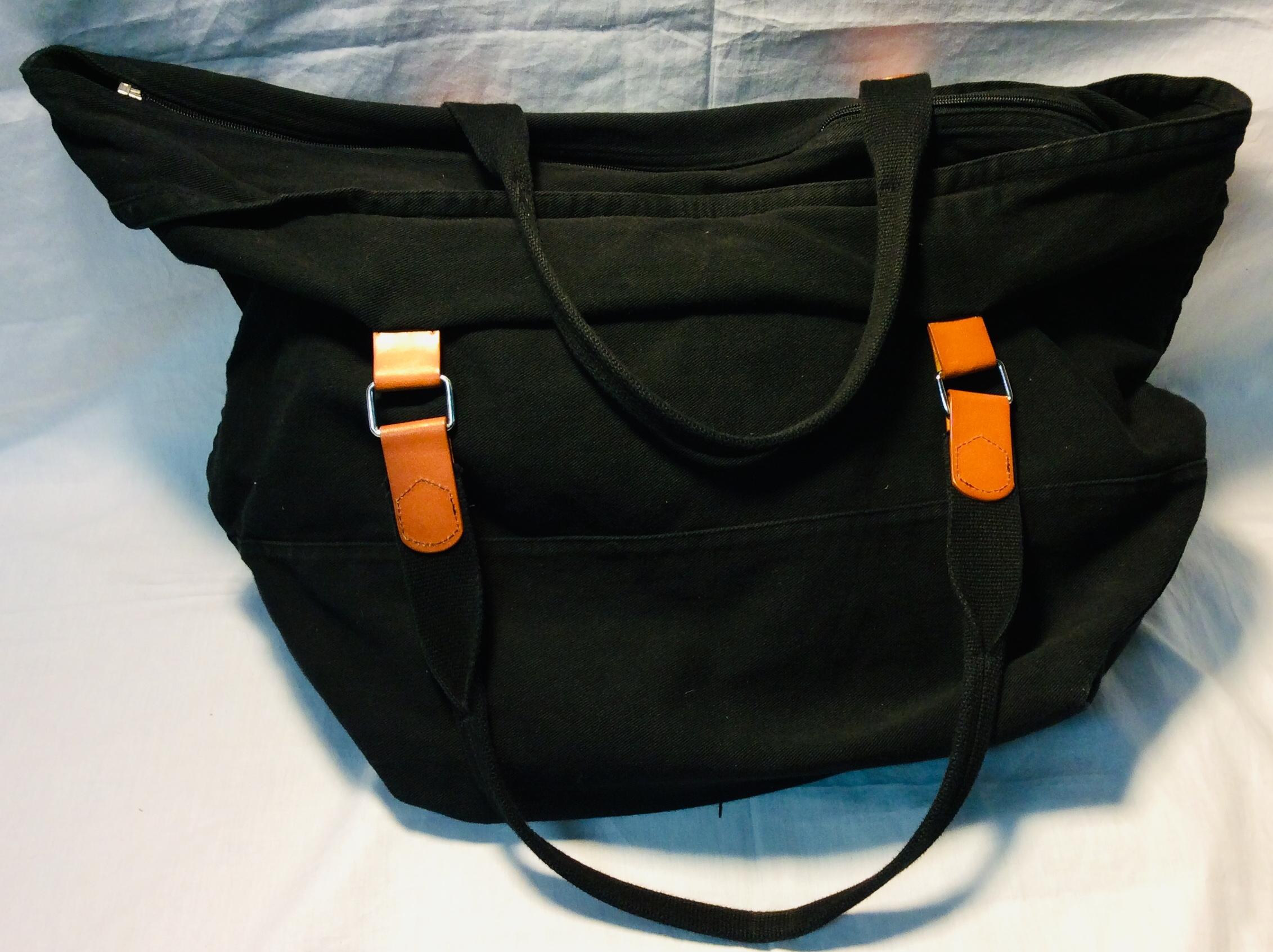 Large, black fabric handbag