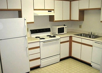 Spacious kitchen countertops and electric stove KW apartments