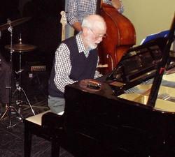 Frank Cox at the piano