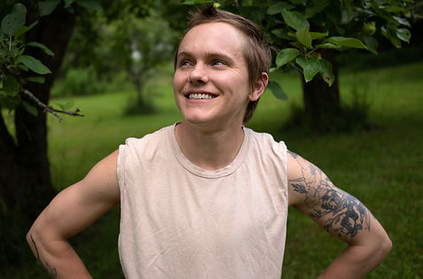 author photo for Sandy Allen, showing him wearing a tanktop and smiling