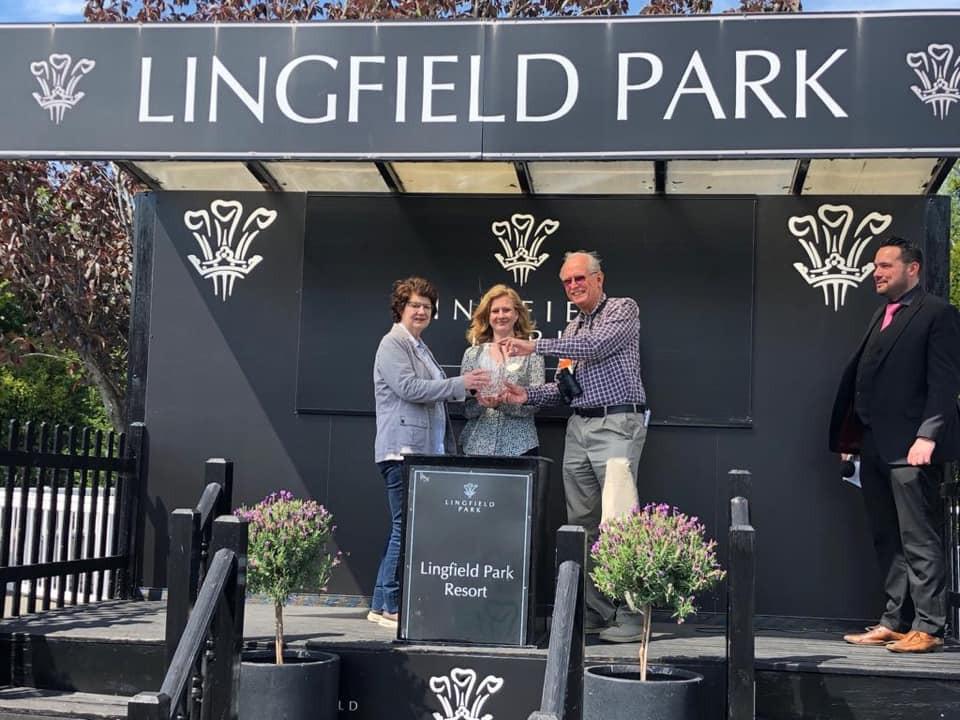 banta bay owners collecting prize at lingfield park resort
