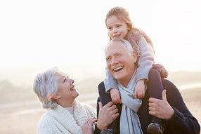 grandparents-and-granddaughter-walking-o