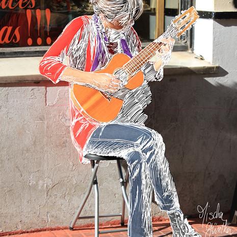 Mujer a la guitarra