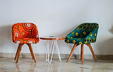 two-assorted-color-padded-chairs-near-si