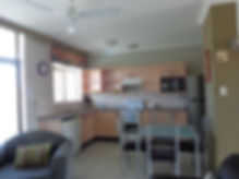 A kitchen at the Tahitian Holiday Apartments