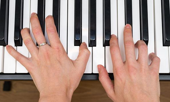 hands, piano keys, top view.jpg