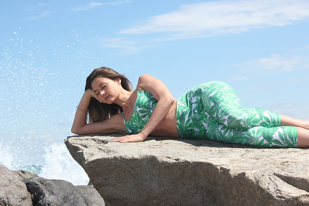 Girl lain down on a rock