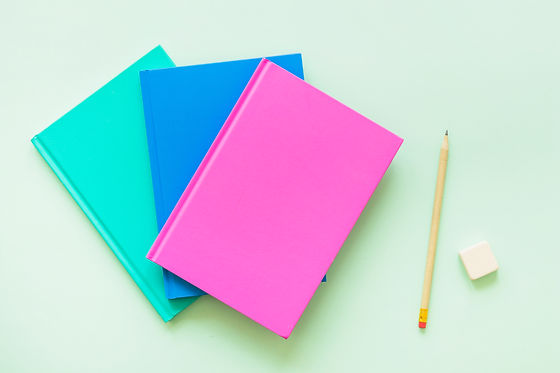 colorful-books-with-pen-and-eraser.jpg