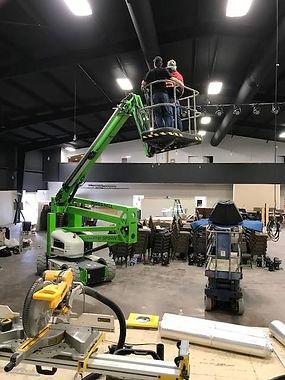 Bucket personnel lift in building