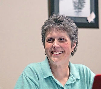 Debi Council smiling in the office