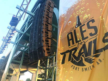 Line array speakers, stage lighting on Ales for Trails event stage