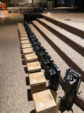 Long row of Elation Pro Lights displayed beside their boxes
