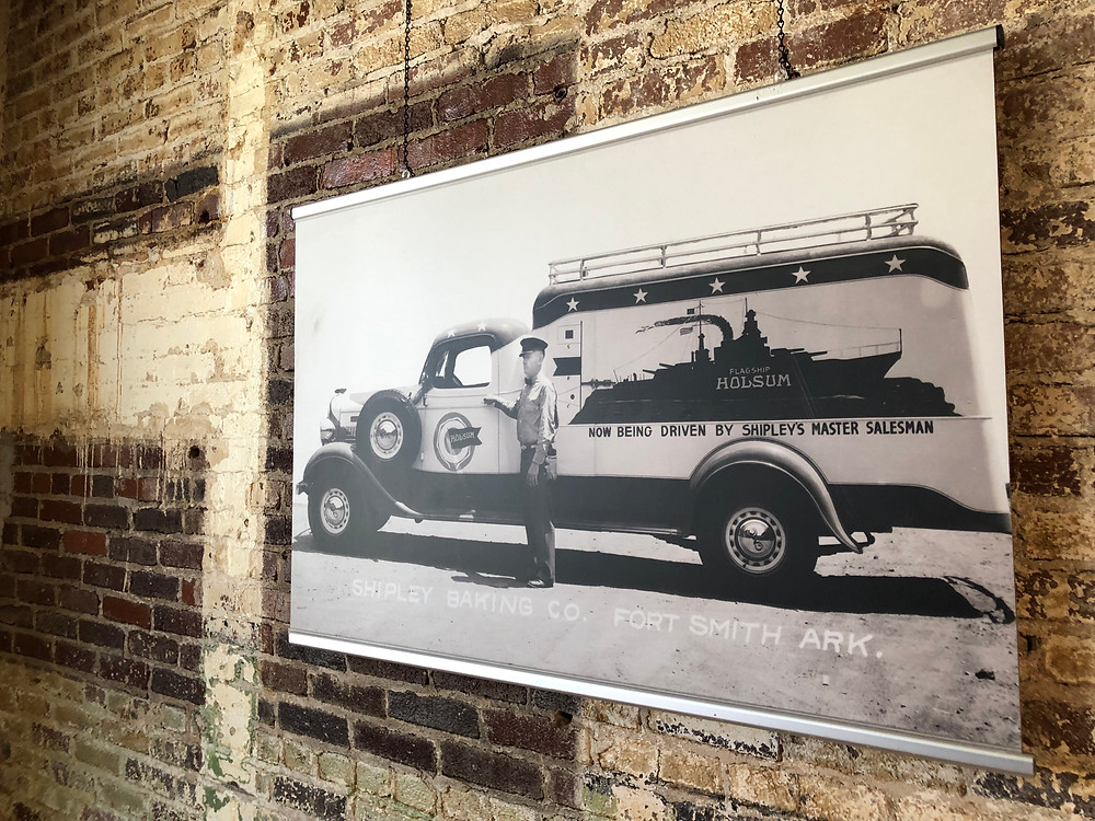 Photo of vintage Shipley's delivery truck hangling on brick wall