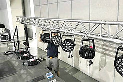 Annidale Crew Member working on lighting on lowered beam