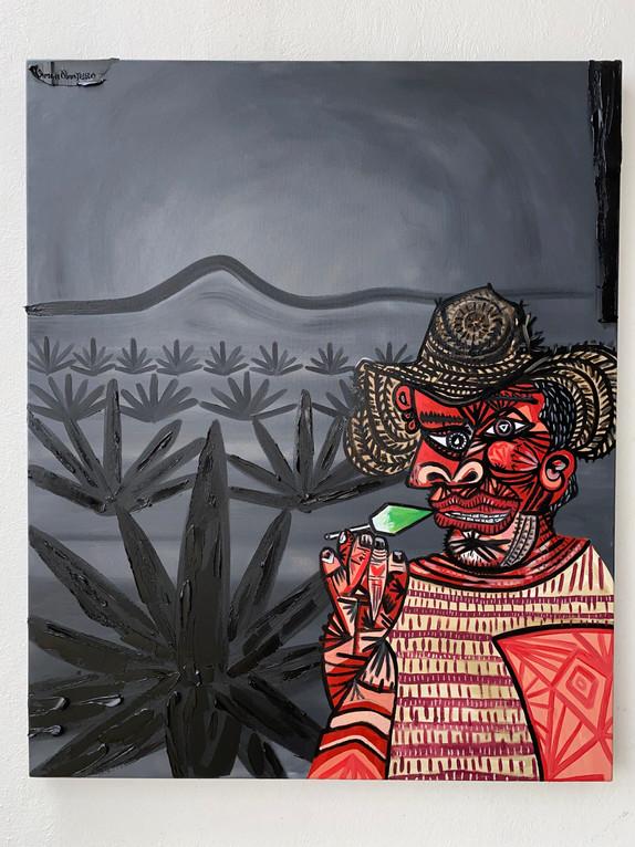 Hombre con piruleta de Picasso entre agaves