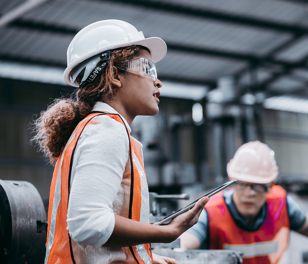 Woman warehouse worker completing task