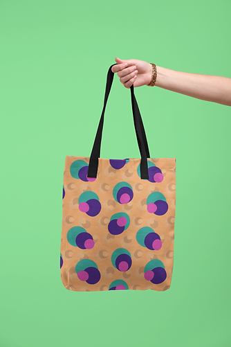 tote-bag-mockup-being-held-by-a-hand-against-a-flat-surface-28830 (2).png