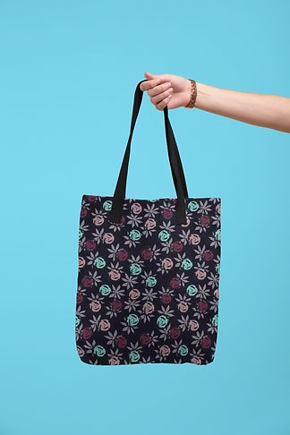 tote-bag-mockup-being-held-by-a-hand-against-a-flat-surface-28830.png