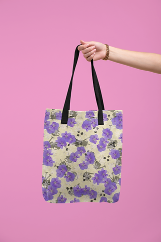 tote-bag-mockup-being-held-by-a-hand-against-a-flat-surface-28830 (1).png