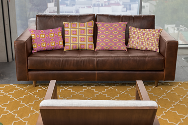 mockup-of-four-pillows-on-a-leather-sofa-23548.png