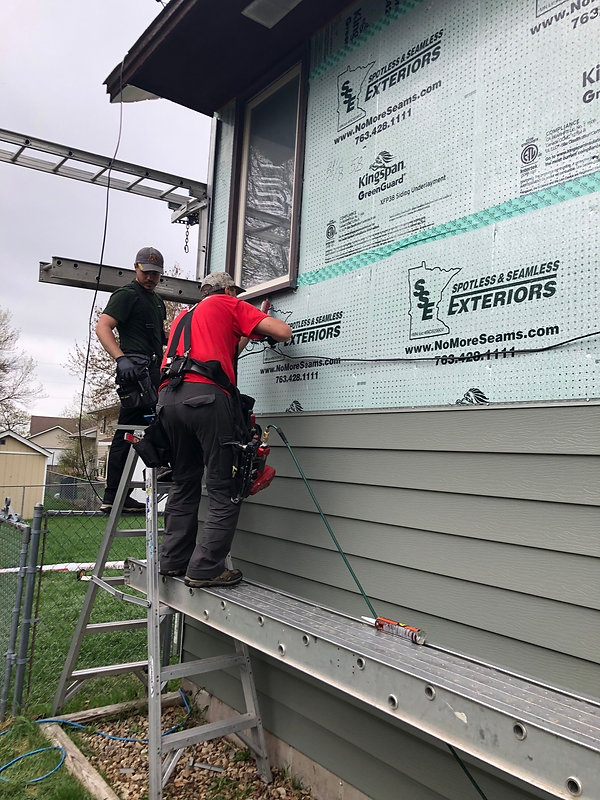 Markin Co employees working on a siding job for a customer.