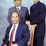 AnAnil Ambani (Right) with his father Dhirubhai Ambani (sitting) and brother Mukesh Ambani (left)il Ambani (Right) with his father and brother