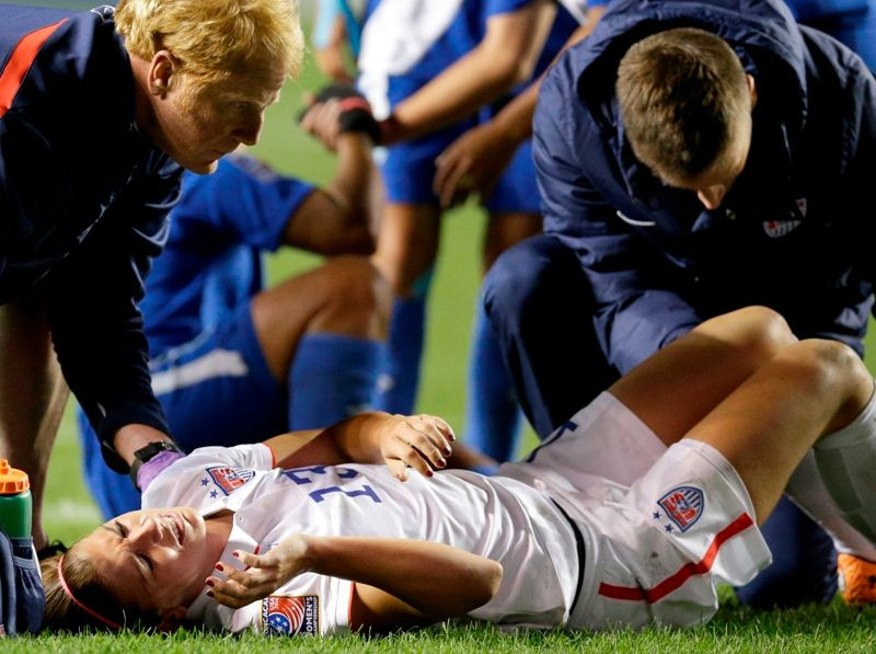 Alex Morgan Lying On The Ground After Getting Injured