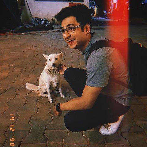 Kenny Sebastian with a dog