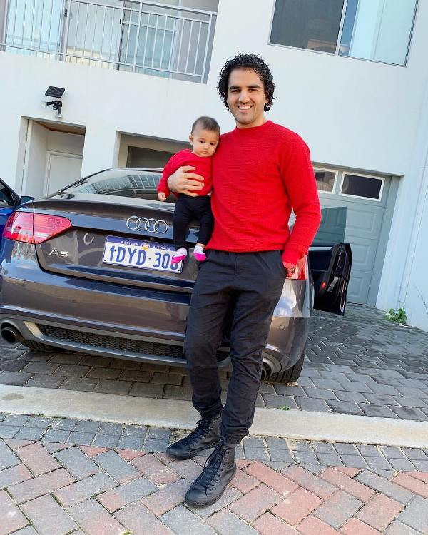 Yusof Mutahar with His Daughter and Car
