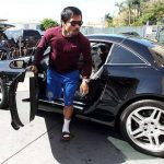 Pacquiao comes out of Mercedes Benz Sl 550